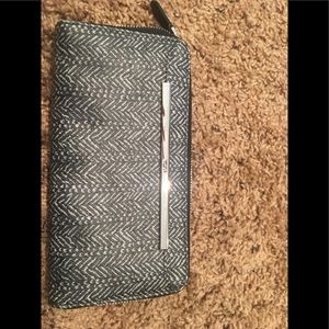 New NWOT Tumi continential herringbone wallet